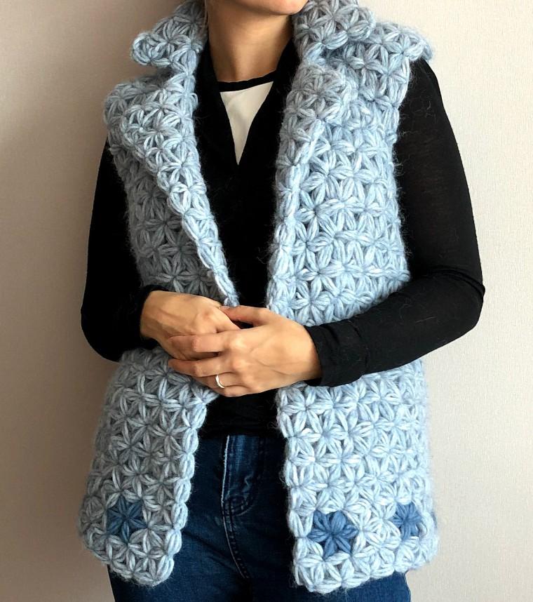 Model wearing the crochet jasmine vest made of jasmine stitch.