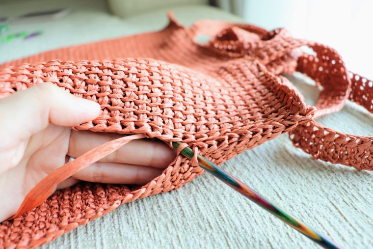How to slip stitch the back loops to close the sides and bottom of the panel.