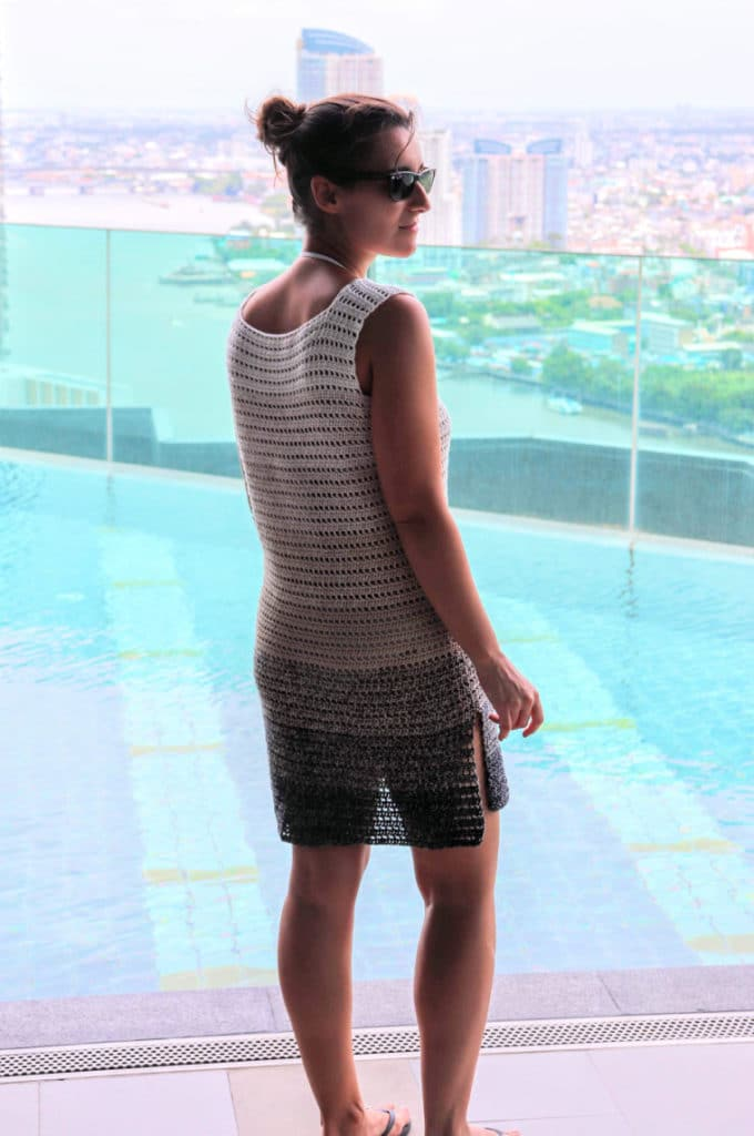 Susana from Fluffy Stitches modeling the Crochet Breezy Beach Dress. View of back