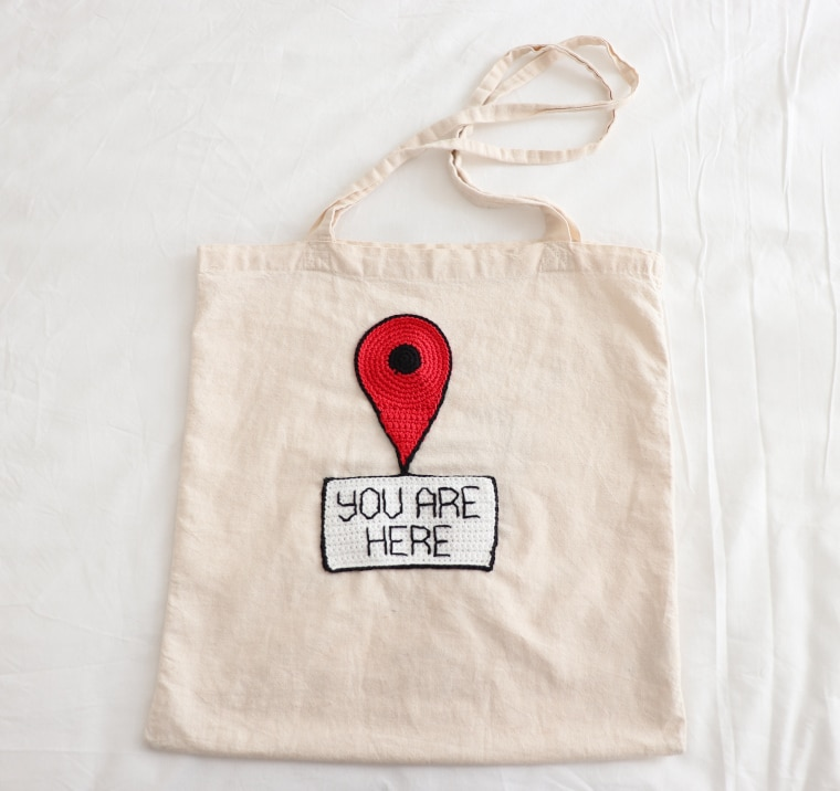 The You Are Here sign sewn to one of my totes
