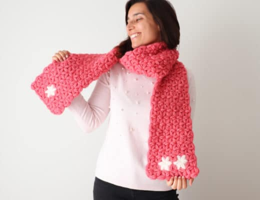 Susana from Fluffy Stitches wearing a bright pink Crochet Jasmine Scarf.